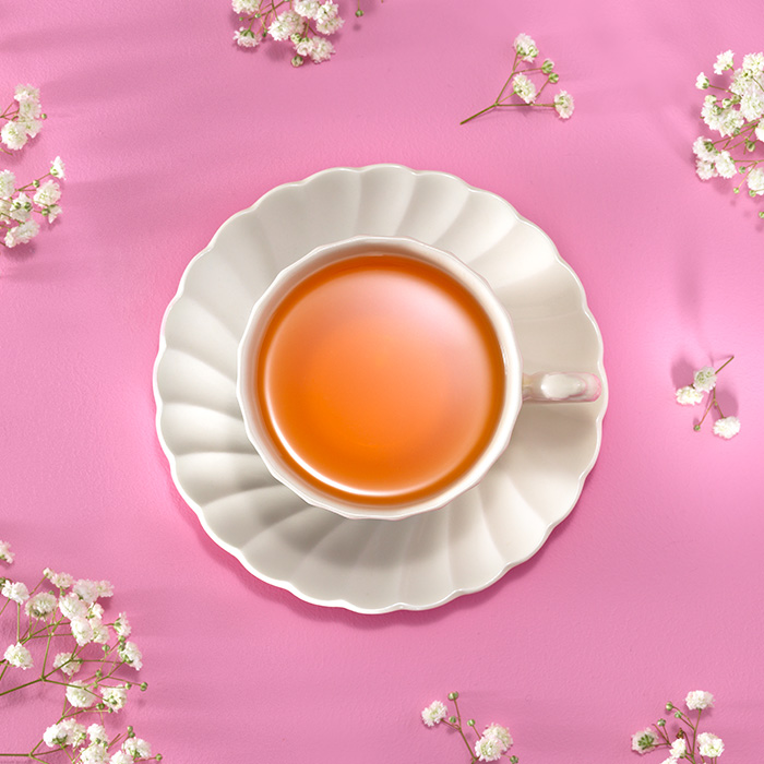 Food photography still life image of cup of tea on pink background