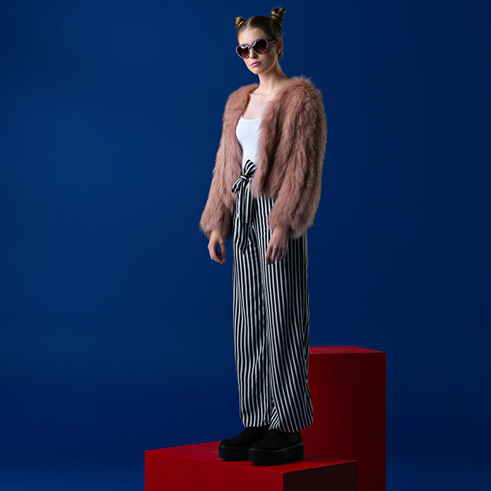 Model standing on red block