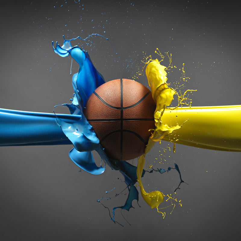 Basketball with blue and yellow paint splashes from the side