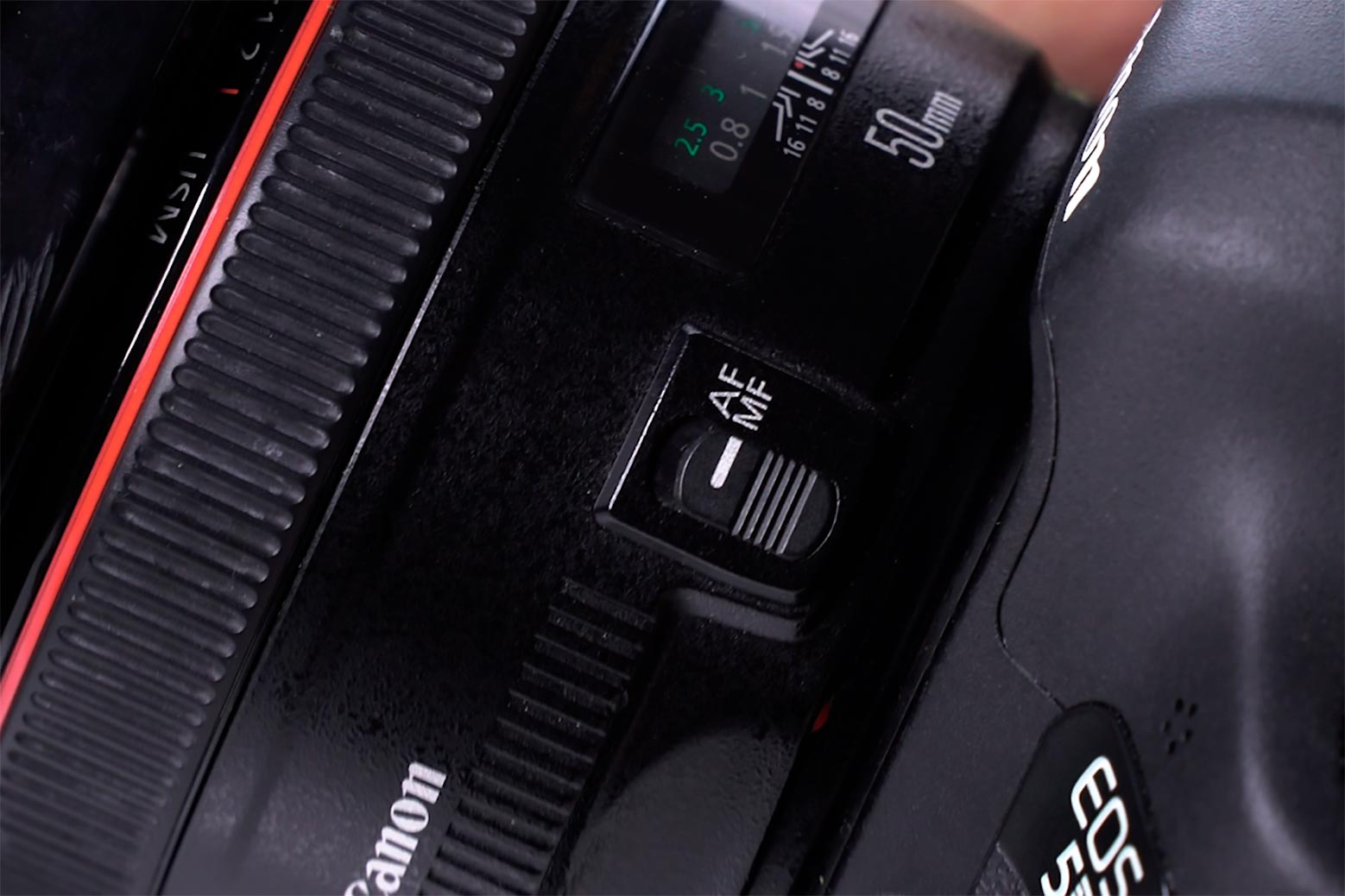 Manual camera focus ring and closeup of AF/MF switch.
