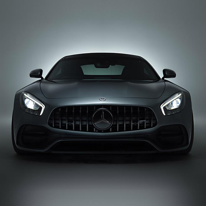 Front view of Mercedes sports car with headlights on