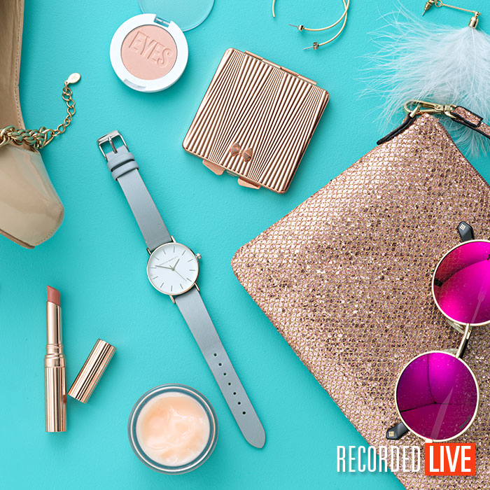 Flay lay of fashion accessories on blue background