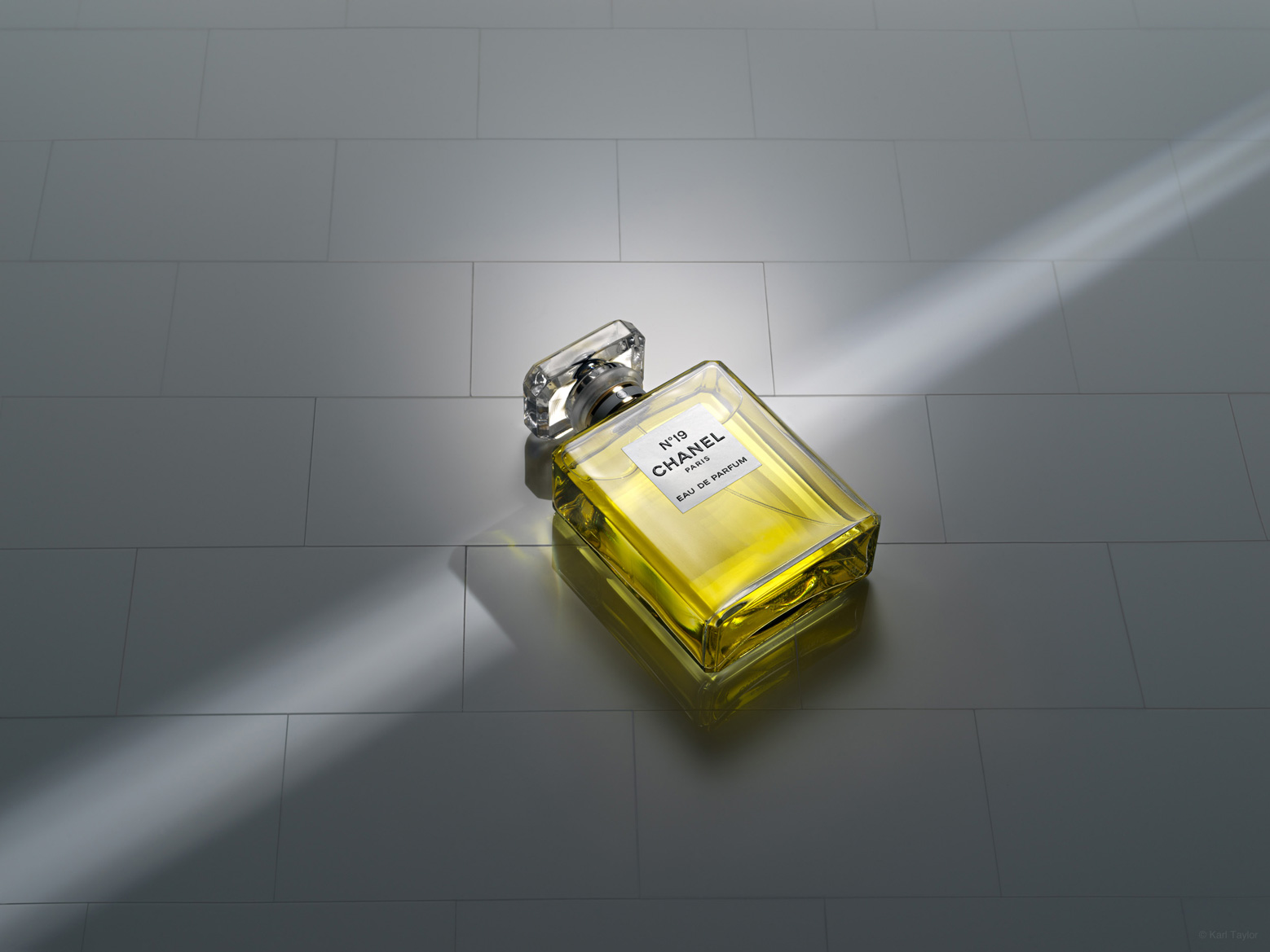 Chanel No.19 perfume bottle in ray of light