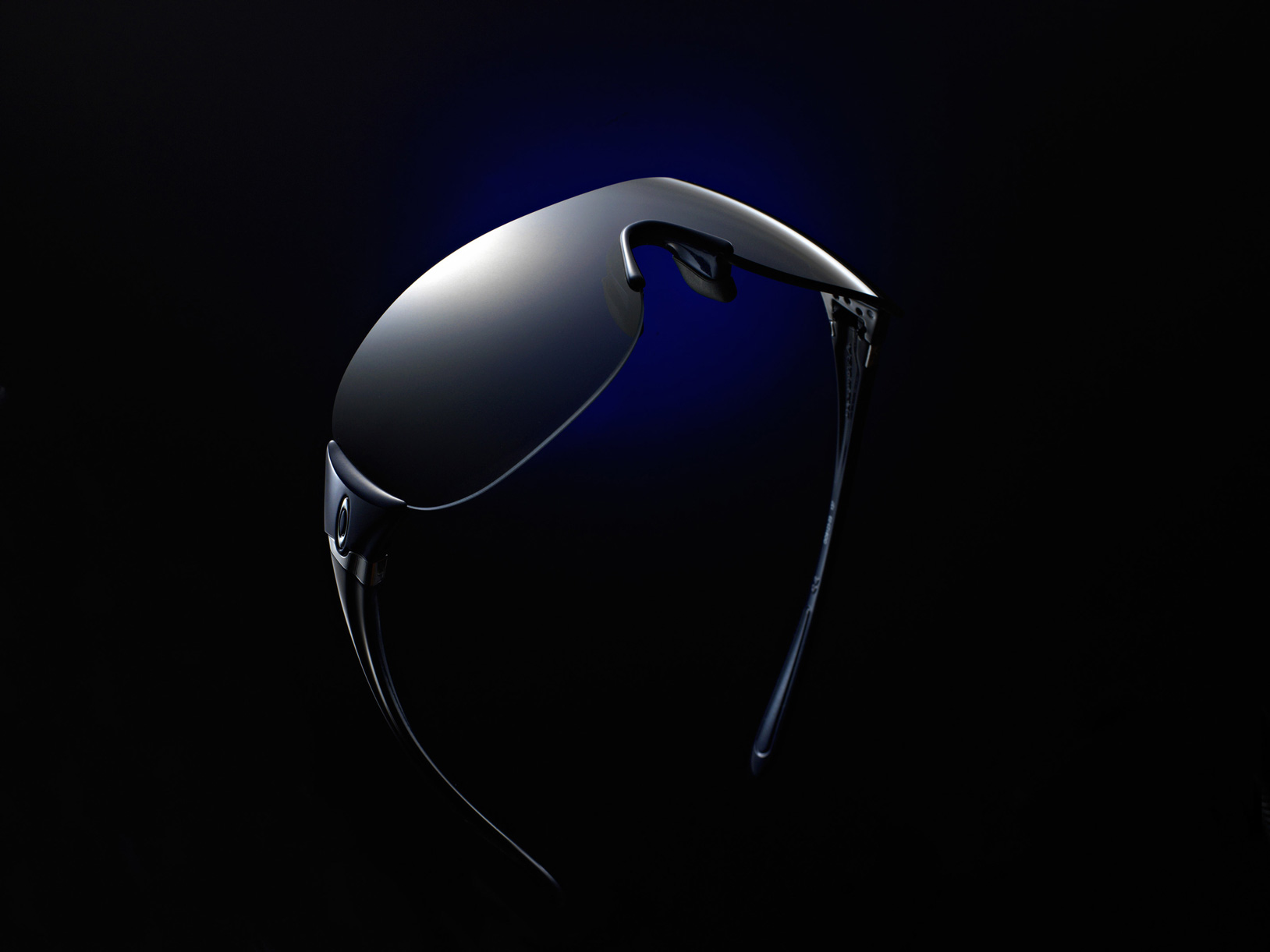 Sunglasses with dramatic lighting on black background