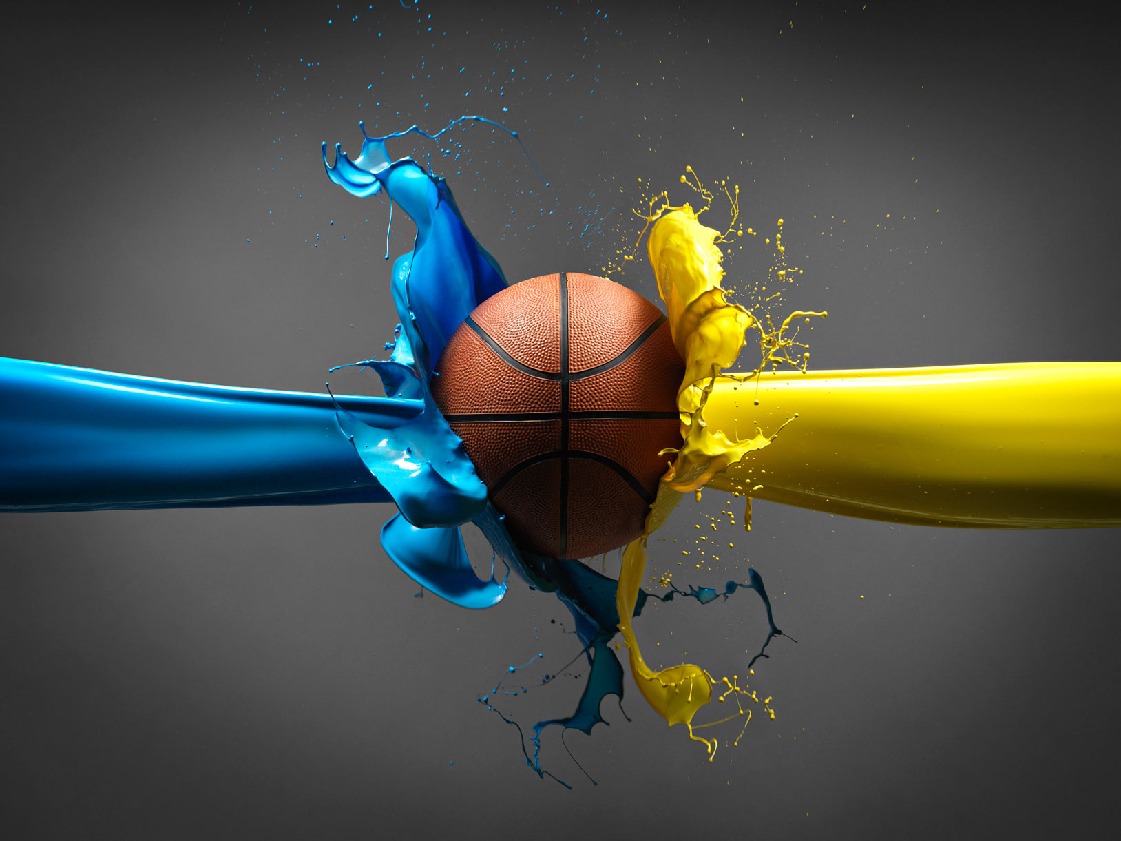 Basketball with blue and yellow paint splash