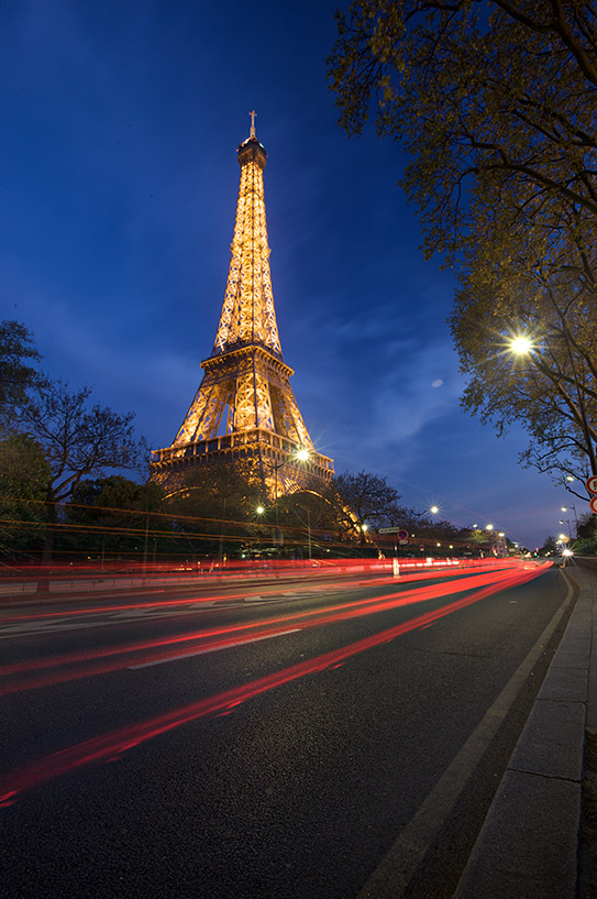 Eiffel tower with long exposure car trails