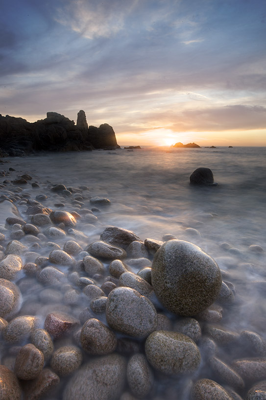 Seascape long exposure of pebbles and water