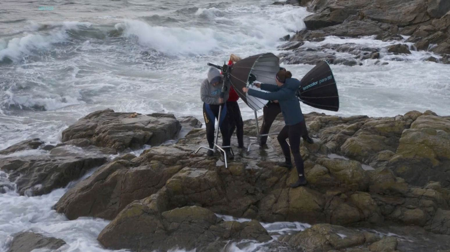 Photographer's assistants on a rocky outcrop